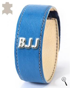 "Leather wrist band with inscription ""BJJ"" (details)"
