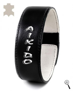 "Black leather band for wrist with inscription ""Aikido"" (details)"