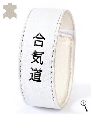 "White leather accessory with inscription ""Aikido"" (details)"