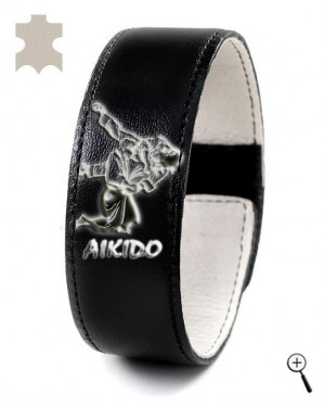 Black magnetic bracelet with drawing of Aikido grip (details)