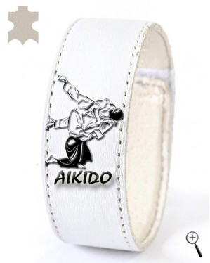 White magnetic band for wrist with image of Aikido grip (details)