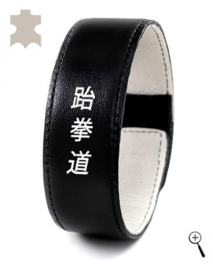 Black leather accessory with inscription Tae Kwon Do on Handja (details)